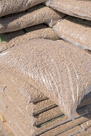 Nylon bags filled with wood pellets - biomass Stockfoto