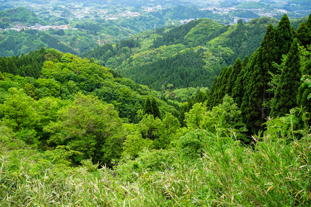 Lush greenery mountain panorama and town view from afar, Takachiho, Japan