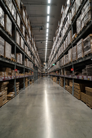 Bangkok, Thailand - April 6, 2017 :Row of packed ready-to-assemble furniture products in warehouse section, IKEA Bangna, Thailand  (portrait layout photo)