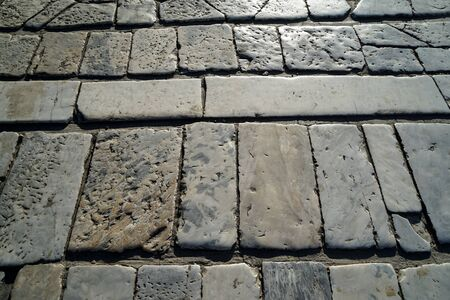 grooves: Closeup white and grey color brick marble stone texture outdoor pavement in natural square and rectangle pattern background under sunlight, historical site, Athens, Greece