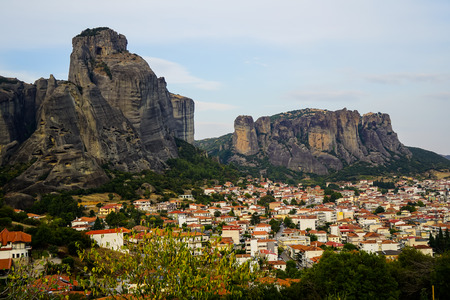 Cityscape view of Kalambaka ancient town with beautiful rock formation mountain, immense natural boulders pillars and sky background, Greece