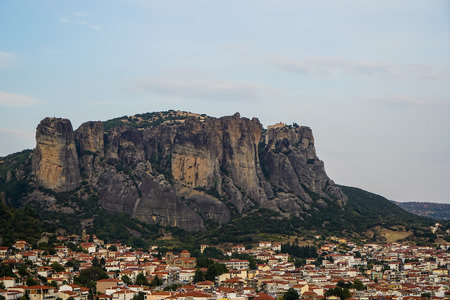 Townscape view of Kalambaka ancient town with beautiful rock formation mountain, immense natural boulders pillars and sky background, Greece