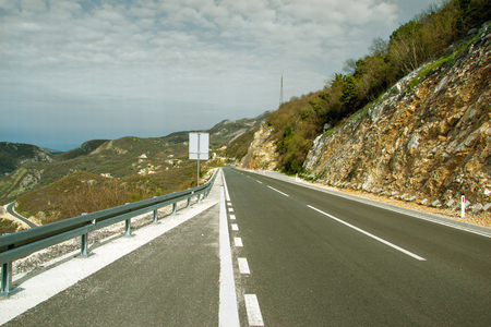highway in the mountains. winding road on a slope. Photo Reklamní fotografie