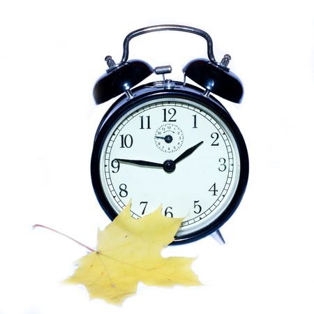 Clock with yellow leaf Stock Photo - 3744629