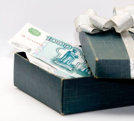 One thousand roubles in dark blue box. Stock Photo