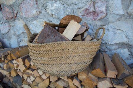 log basket: Firewood in a basket Stock Photo