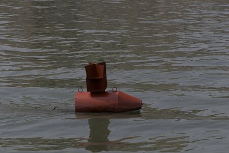 buoy: Red buoy in a river