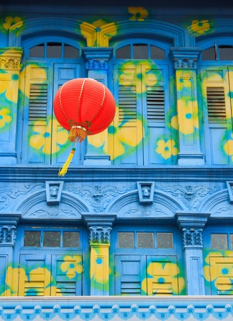 Chinese lamp with  colorful building background photo