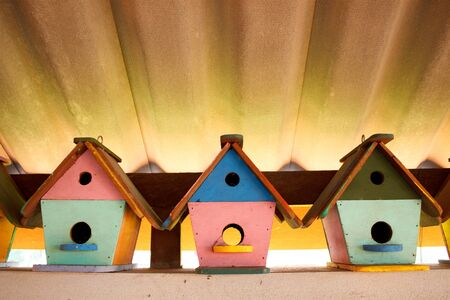 Colorful bird houses under the roof in Thailand photo