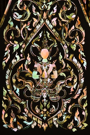 asian angel: Thai art made from pearl on the  door of Rarchabophit temple Thailand.