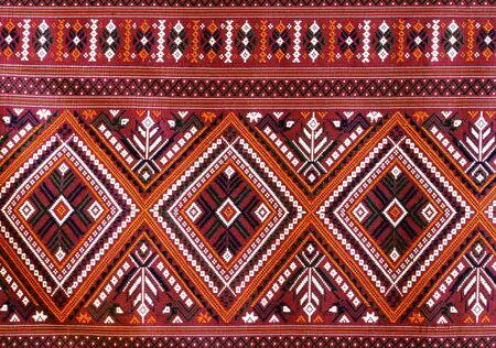 The Elegant Thai art on hand-woven fabrics photo