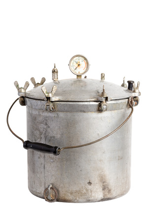 Antique aluminum pressure cooker    canner on a solid white background Imagens