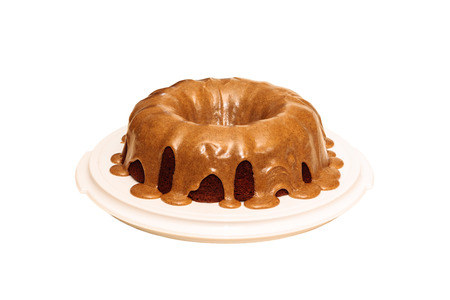 spice cake: Applesauce raisin spice cake on a cake server on a white background