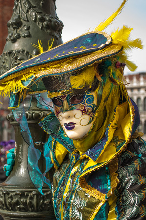 Yellow turquoise feather venice mask costume Stock Photo