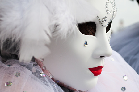 White red tear drop gem feather venice mask costume Stock Photo