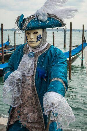Blue venice mask costume gondola bay background Stock Photo