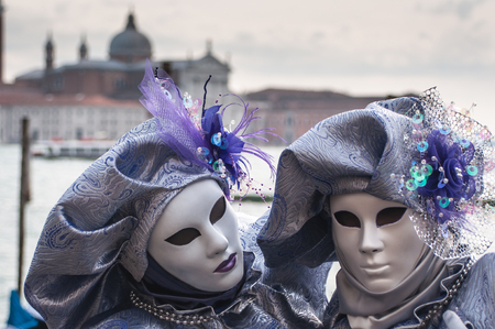 Purple venice mask costume church bay background Stock Photo