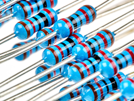 Close up group of blue color electronic resistors on a white background