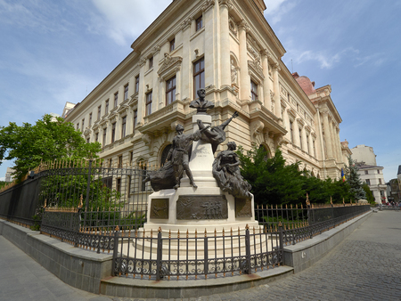 Monument to Eugeniu Carada (1836-1910), founder of The National Bank of Romania and the head office of the National Bank of Romania, as seen from Lipscani Street Editorial