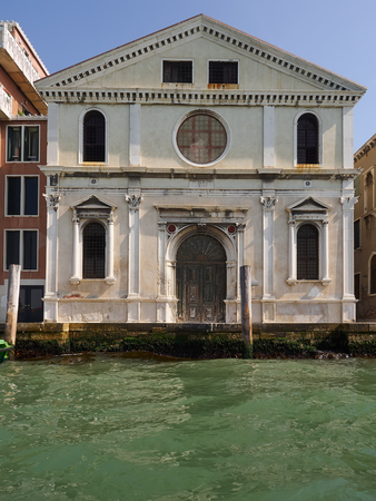 Front facade of an old Venetian church on a canal in Venice, Veneto, Italy, a listed UNESCO World Heritage Site and popular tourist destination Editorial