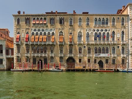 The historic exterior Gothic facade of part of the Ca Foscari University, Dorsoduro, Grand Canal, Venice, Italy