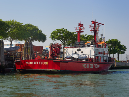Bright red fire tender or boat of the fire brigade, Venice, Veneto, Italy moored at the port