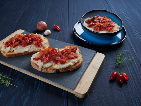 Mashed beans spread with garlic vegetable oil, with a topping of sauteed onions and tomato paste (Romanian: fasole batuta), an all-time favorite during lent and other times of religious feasting