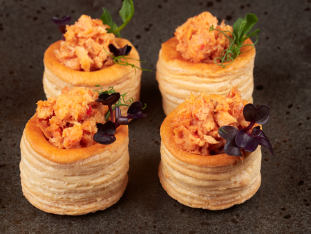 Puff pastries with a spicy, chunky salmon filling Stock Photo
