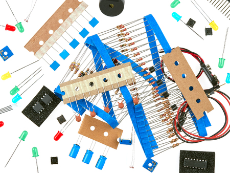 A selection of active and passive electronics components: buttons, LEDs, resistors, capacitors, buzzer, connecting wires, transistors and integrated circuits Stock Photo