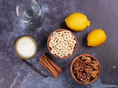 Ingredients for Romanian mucenici or macinici: figure eight shaped pasta, boiled in water with sugar, cinnamon and crushed nuts. Traditional dessert for the Christian feast of the 40 Martyrs of Sebaste