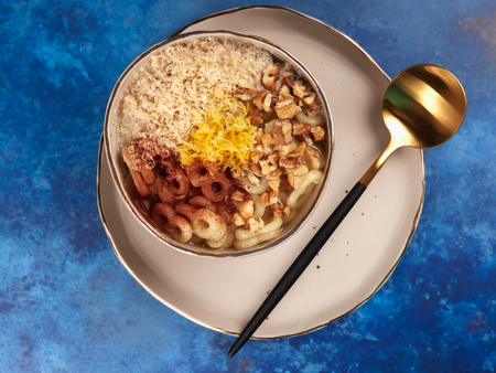 Romanian mucenici or macinici: figure eight shaped pasta, boiled in water with sugar, cinnamon and crushed nuts. Traditional dessert for the Christian feast of the 40 Martyrs of Sebaste