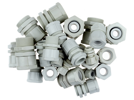 A group of plastic cable glands isolated on white background Stock Photo