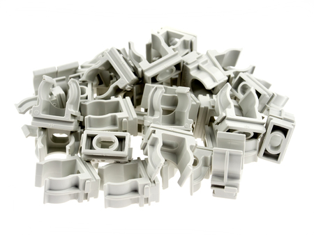 Plastic clamps for electrical tubing, isolated on white