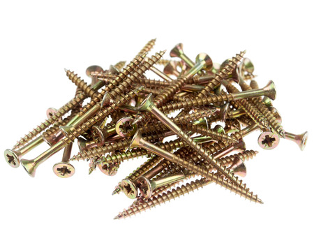 A group of yellow wood screws, isolated on white
