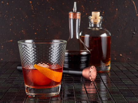 Old fashioned: a cocktail made by muddling sugar with bitters, then adding bourbon, and a twist of citrus rind