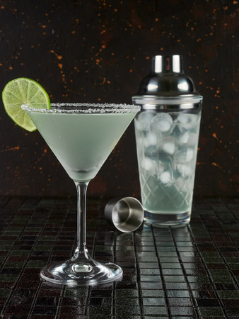 Classic margarita: a mix of tequila, orange liqueur, and lime juice, served with salt on the rim of the glass Фото со стока