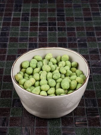 Crunchy whole peanuts tossed in a wasabi-flavored coating