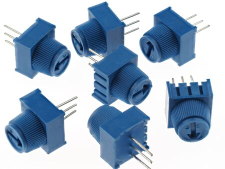 Group of blue potentiometers for PCB mounting, isolated on white. Electronics spare parts. Imagens