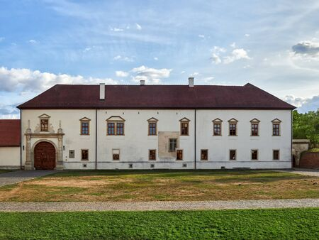 Alba Iulia, Romania - September 20, 2019: The roman-catholic episcopacy palace is located to the South of the Saint Michael's cathedral in Alba Iulia, Romania