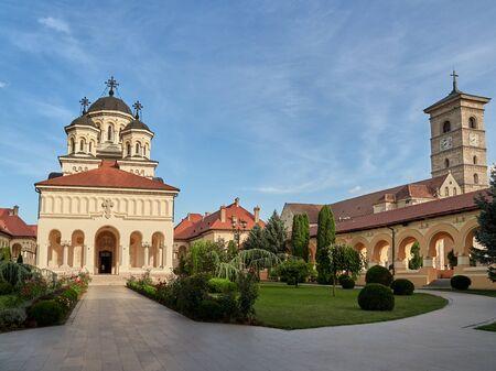 Alba Iulia, Romania - September 20, 2019: The orthodox Reunification Cathedral (left) and the Saint Michael's catholic cathedral (right) inside Alba Carolina Fortress. Alba Iulia, Romania