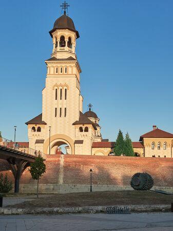 Alba Iulia, Romania - September 22, 2019: View of bell tower of Reunification Cathedral inside Alba Carolina Fortress. Alba Iulia, Romania, Europe
