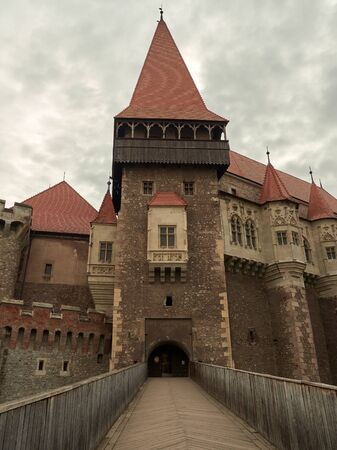 Hunedoara, Romania - September 23, 2019: The Corvin Castle or Hunyadi Castle, is a Gothic-Renaissance castle in Hunedoara, Romania. Castle entrance and the wooden bridge. Editorial