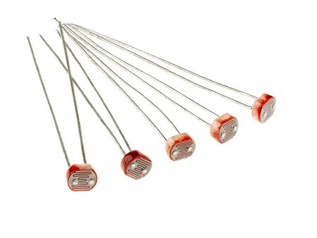 A group of photoresistors (or light-dependent resistor, LDR, or photo-conductive cell), isolated on white.