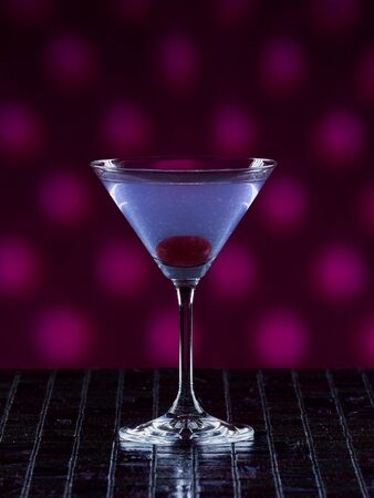 Aviation cocktail on pink dotted background 免版税图像
