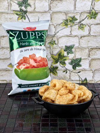 Bucharest, Romania - November 25, 2019: Zupps, a local brand of deep fried pork rinds, resembling chicharrons. Novelty food.