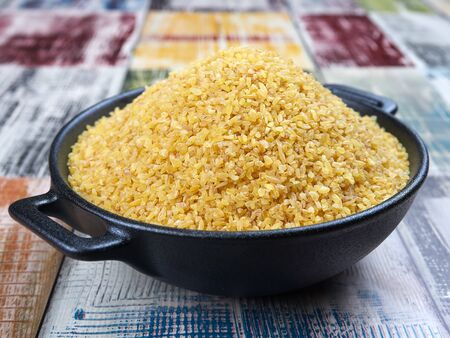 Uncooked bulgur wheat: a common ingredient in cuisines of many countries of the Middle East and Mediterranean Basin