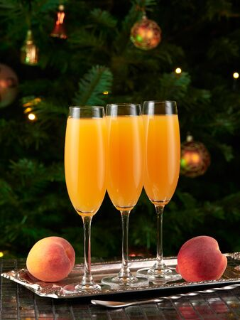 Bellini cocktails, Christmas tree in background