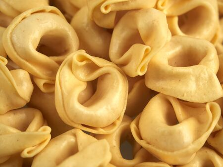 Dried tortellini pasta with cheese filling        Stock Photo