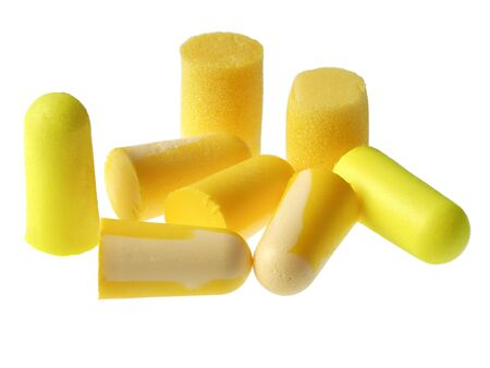 Yellow earplugs for protection against loud noise, isolated on white