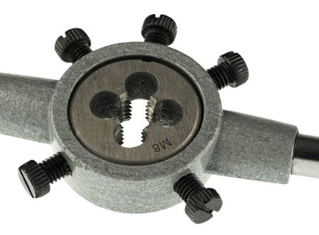 A die used to create metric eight screw threads, with its holding tool Stock Photo